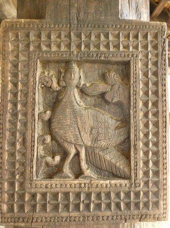Embekke Devalaya : Wooden carving on the column depicting Garula, a mythical bird
