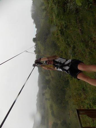 Zip Line at Monkey Jungle: rain didn't stop the fun of the zipline!