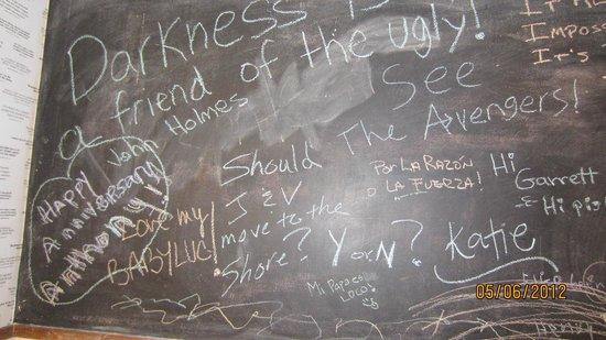 The Cave Store: Blackboard in bathroom where we had dinner
