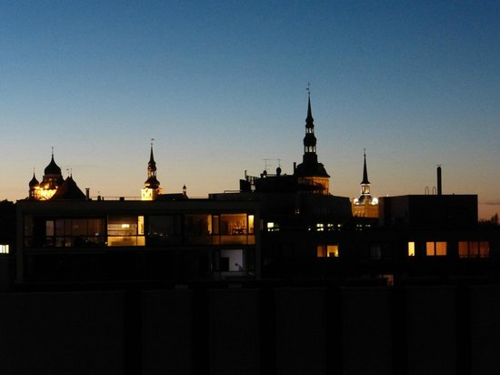 City Style Apartments: Silhouette of Old Town at Sunset