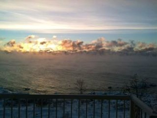 Cove Point Lodge: View of lake from our room at sunrise. Smoke on the water, fire in the sky!