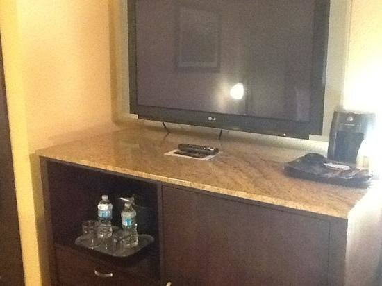 Wyndham Garden Oklahoma City Airport: updated appointments in the room. in this cabinet is a microwave and mini fridge