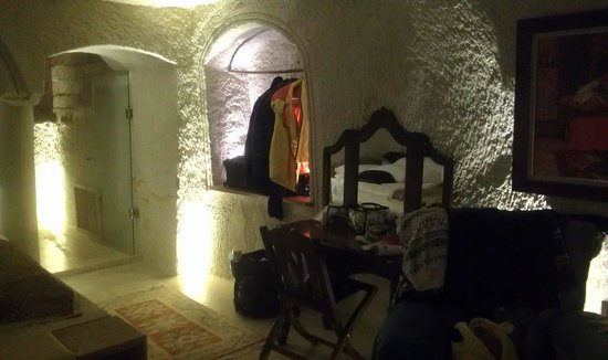 Ottoman Cave Suites: Dressing table, open wardrobe, and corridor leading to bathroom