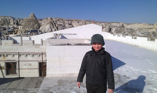 Ottoman Cave Suites: The white snow- capped terrace at roof top in the hotel where my sons play snow ball fights.