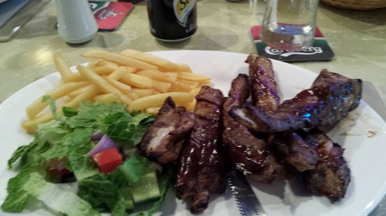 Oasis Club: The 'generous' portion of ribs...prepare to get messy. Yummy