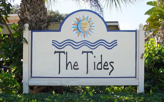 The Tides Sign In Front Of Restaurant