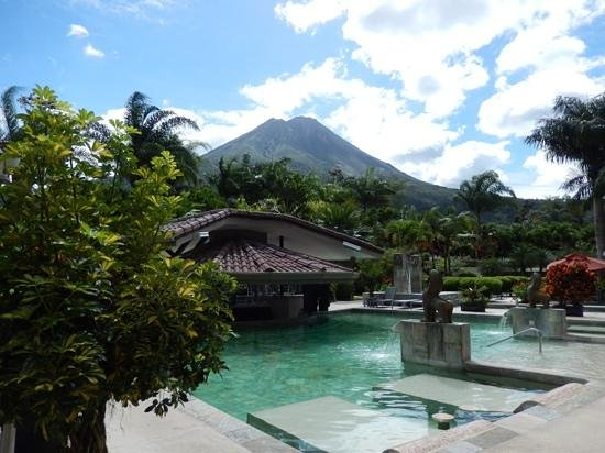 The Royal Corin Thermal Water Spa & Resort: View from room. Thermal pools at the base of the volcano