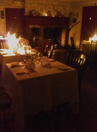 YE OLDE TAVERN: No lights, just the flicker of candles and the roar of a fireplace.