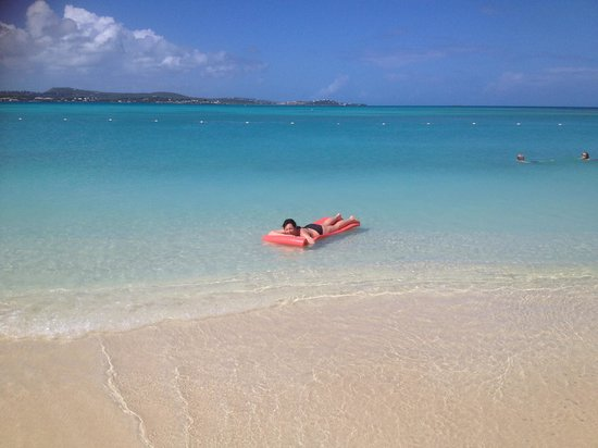 Jumby Bay Island : Crystal clear waters and a lovely Lilo to relax on!
