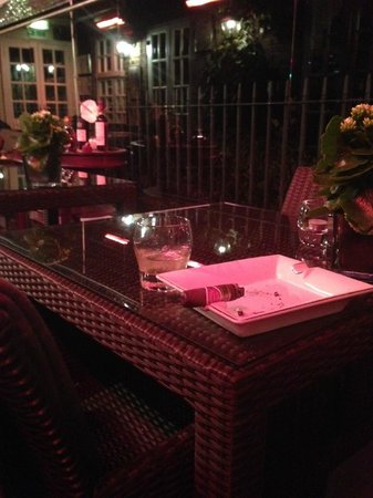 The Montague on The Gardens : Having a Cigar on the terrace