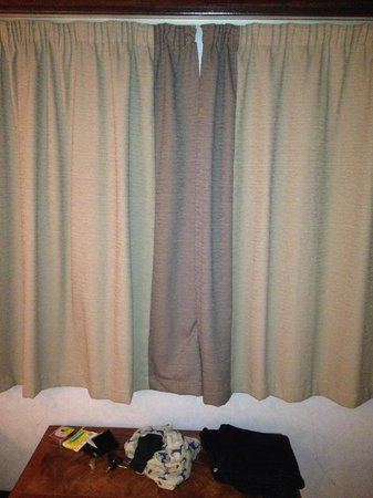 Europa Gatwick Hotel: Curtains don't fit, so patched up with someone else's?