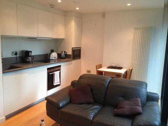 Scotia Grand Residence - Quartermile Apartments: Living room and kitchen