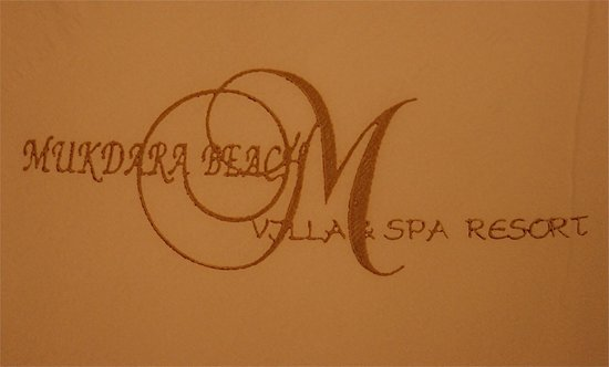 the Mukdara Beach Villa and Spa Resort LOGO
