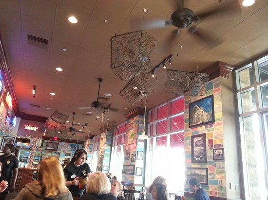 Wintzell's Oyster House: Interior of main dining area ... nice crab pots hanging from ceiling.
