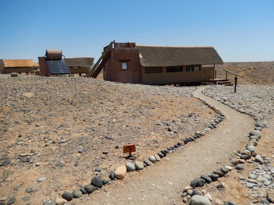 Wilderness Safaris Kulala Desert Lodge: Hut With Ladder and Roof Top Sleeping Area Visible