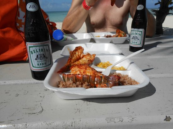 Belize Cruise Excursions - Goff's Caye Beach and Snorkeling Tour : 2 lobster tails, rice, and corn for $10 USD. Belikin beer is 2 fro $5.00