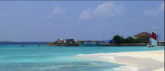 Robinson Club Maldives: The supply island as seen by some of the beach villas and the water sports centre