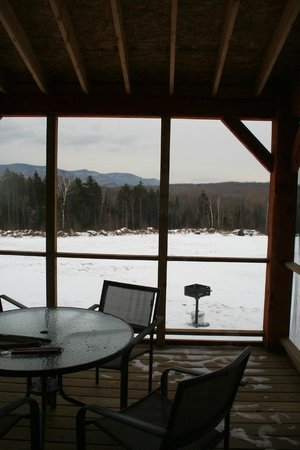 Robert Frost Mountain Cabins: view through our porch to meadow and mountains
