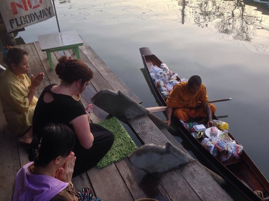 Baanrak Amphawa: Early morning offering to Monks on the river from the deck of the hotel where we had breakfast.