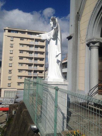 Miuracho Catholic Church : Larger than life Jesus Statue outside Church at the top of the 80 stairs