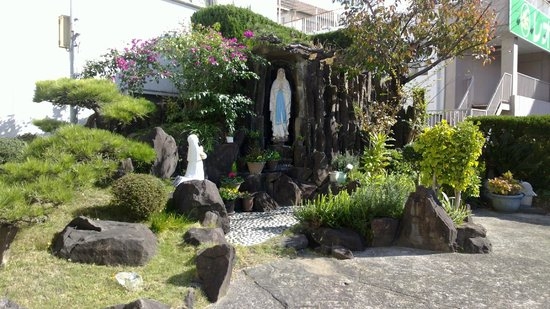 Miuracho Catholic Church: Grotto with Our Lady and Bernadette statues outside Church