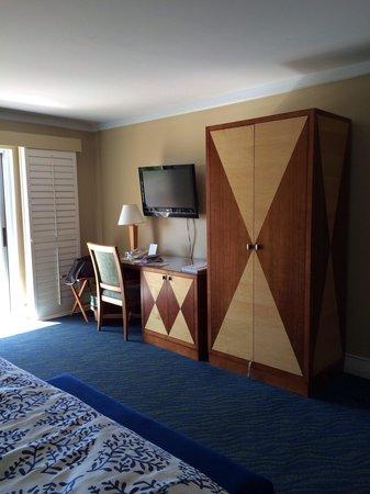 The Naples Beach Hotel & Golf Club: Desk, dresser, and wardrobe in 619 Watkins building