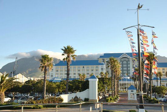 view of the table bay hotel with table mountain in the back