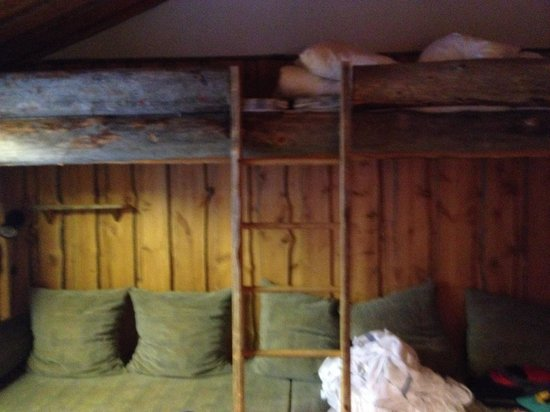 Pyha Log Cabins: 3* cabin sofa which we slept on and beds above