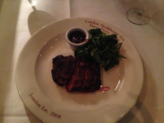 Marco Pierre White Steak and Alehouse : Rare house cut steak, with red wine and port sauce, and watercress.
