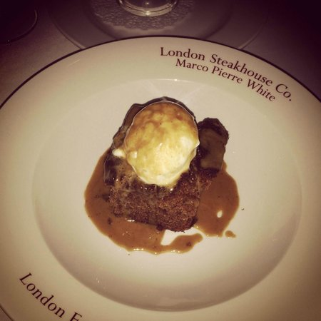 Marco Pierre White Steak and Alehouse : Sticky Toffee Pudding - unfortunately, looks like someone in the kitchen had a bite out of it fi