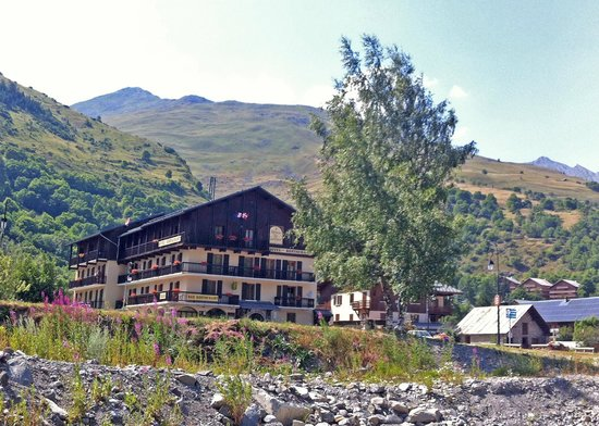 Hotel Relais du Galibier: View from the river opposite the hotel.  So many wild flowers in the Alps!