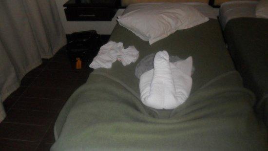 Hotel Paradis Palace : deco sur lit
