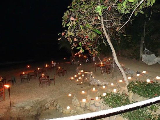 Rhythms of the Night by Vallarta Adventures: candles on the beach for tables. (taken with a flash)