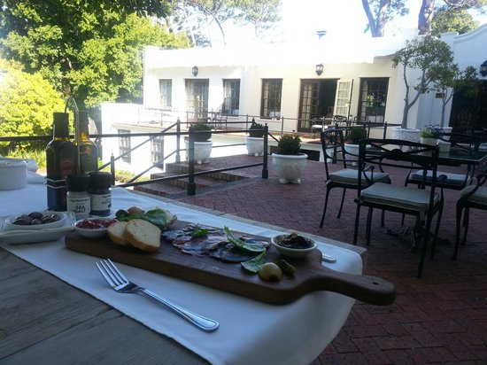 The Andros Boutique Hotel: Enjoy a delicious snack on the patio