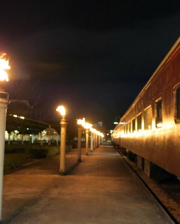Chattanooga Choo Choo: Gas Lit Torches reflected on Train car