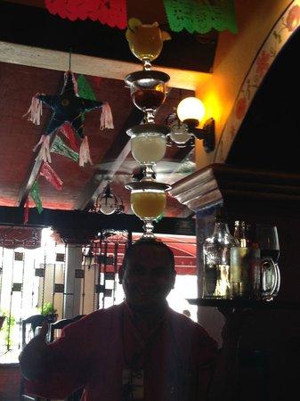 La Parrilla: Famous waiter that balances drinks on his head- fun!