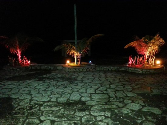 Negril Escape Resort & Spa: The main dining hall patio lit up at night.