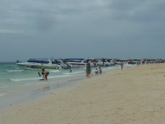 Phuket At Andaman - Day Tours: Lots of tour boats lined up on a beach.