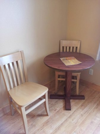 Mt. Olympus Resort: Table and chairs, wood floor