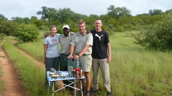 Naledi Bushcamp and Enkoveni Camp: Oupa, Shaun and guests at game drive tea.