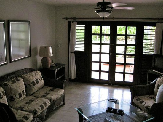 Cabarete Beach House at Nanny Estates: lounge area with private patio outside