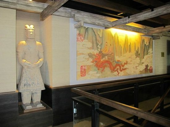 The statue and the mural on the second floor picture of for Bonifacio mural
