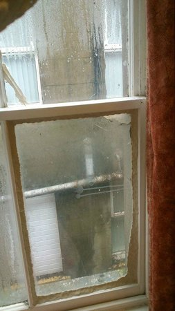 The Florida Hotel: mouldy dirty bodged up window