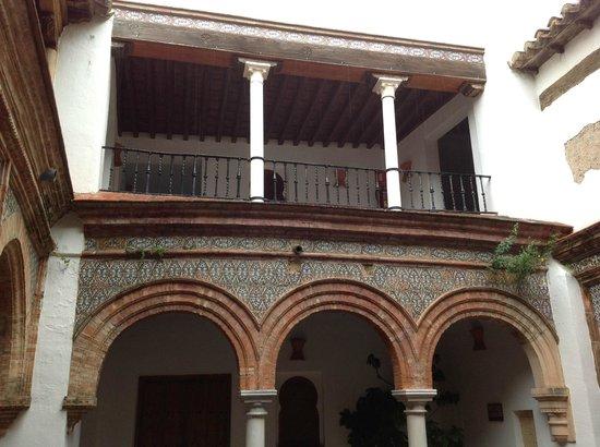 Palacio de Mondragón: An arcaded patio with original Moorish mosaics and plasterwork