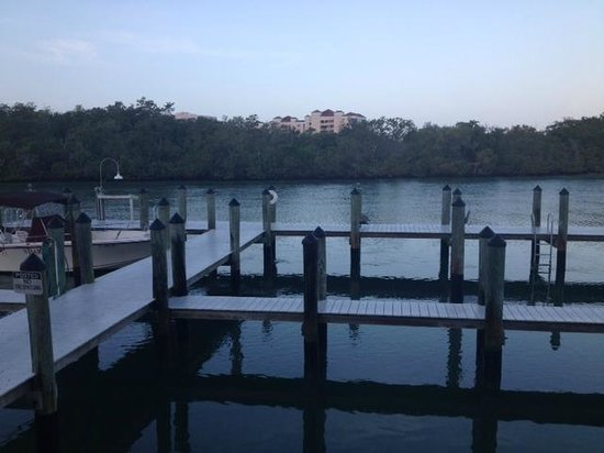 The Boat House Motel: Pier off patio outside condo--facing wooded shore opposite