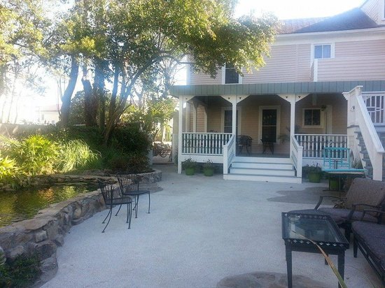 Back of the Kenwood Inn, with seating area and koi pond.