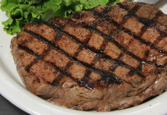 Branding Iron BBQ & Steakhouse: Hand cut steaks cooked on an open flame charbroiled.
