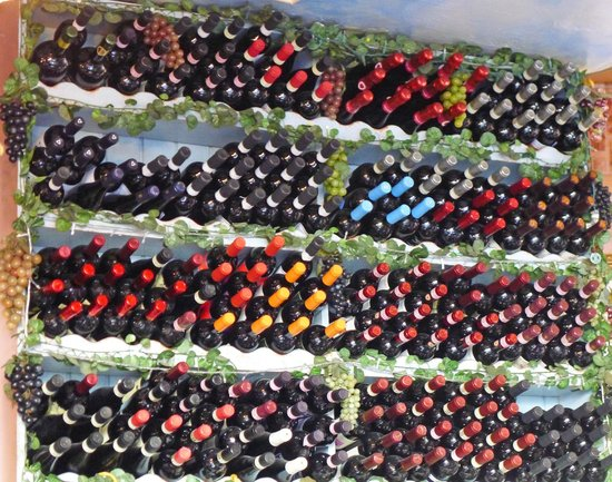 Ristorante Franchino: Colorful bottles on display