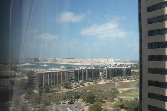 Media One Hotel Dubai: View from our room of CNN and other media buildings (Note the dirty windows)