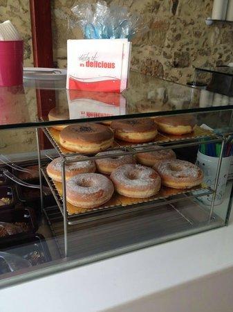 Yog-inn Frozen Yogurt & Master Waffles: A display of our deliciously yummy donuts.....